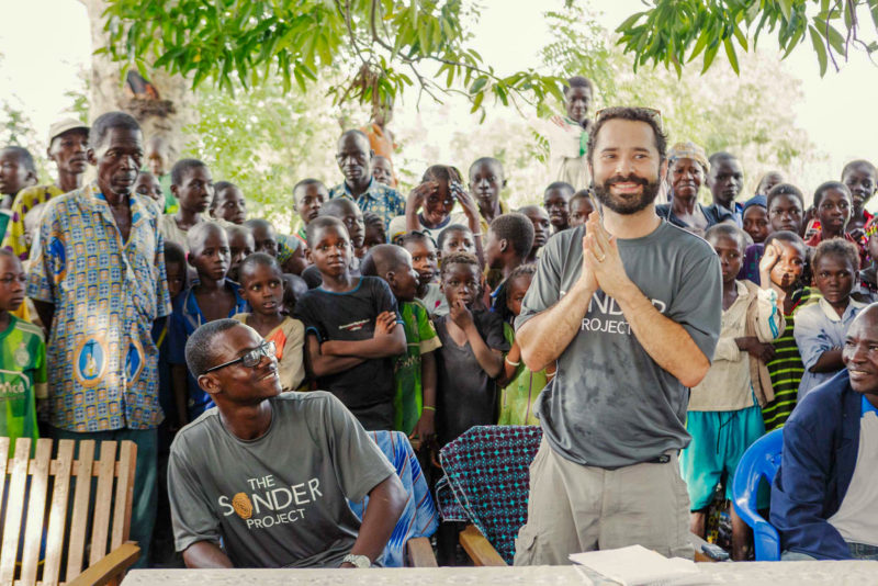CEO Chad Zibelman of The Sonder Project is welcomed during a ceremony in the community of Komsnedego in Burkina Faso, West Africa