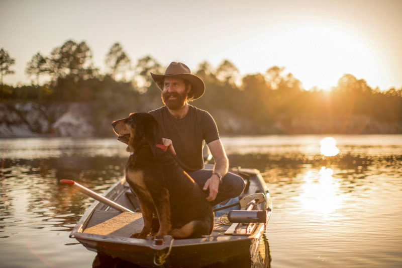 Sean Dietrich on boat with dog